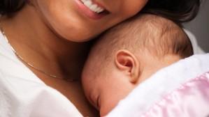 أم تحتضن طفلها وهو ملاصق لها  picture found on  www.coles.com.au