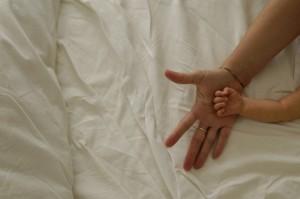 ملامسة يد الطفل بحنان يعزز الأمان والثقة لدى الطفل Picture found  www.steadyhealth.com